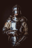 Male in ancient armor. Isolated on black