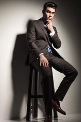 business man sitting on a stool