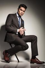 young elegant business man sitting