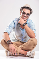 Handsome casual man sitting and smiling