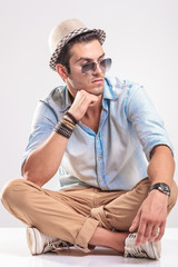 Young casual man looking away and thinking