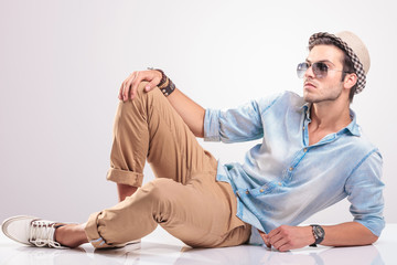 cool fashion man relaxing on the floor