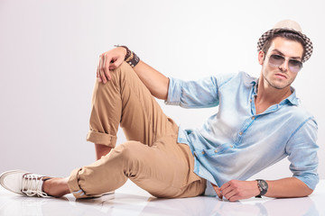 Young casual man resting on the floor