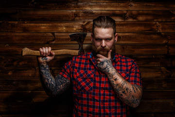 Strict brutal huge male with beard and axe