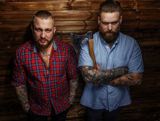 Two huge brutal males with tattooes and beards