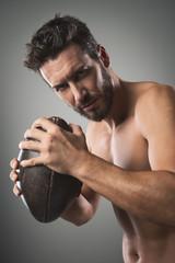Shirtless football player