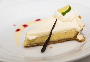 Slice of Key Lime Pie Garnished with Chocolate Straw