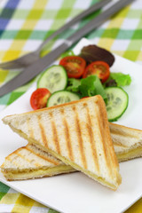 Toast with cheese and side green salad