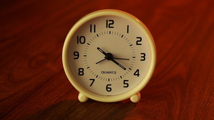 Dolly shot of clock on wood background