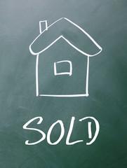 house sold sign on blackboard