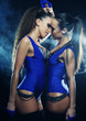 two  striptease girls over dark background