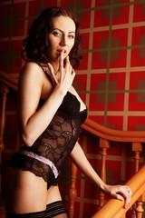 sensual brunette woman wearing sexy black lingerie