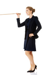 Businesswoman holding rope