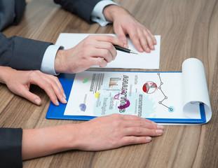 businesspeople analyzes charts