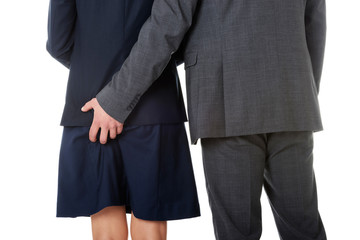 Businessman holding hand on partners ass