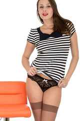 Young Woman Posing in Stockings and Tee Shirt