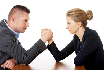Businesspeople fighting on hands