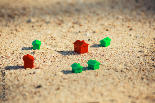 Small plastic houses on the beach