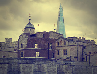 London old and new. Tower with Shard on skyline. Gloomy day.