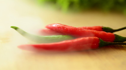 Fresh red and green chili concept with cool water steam