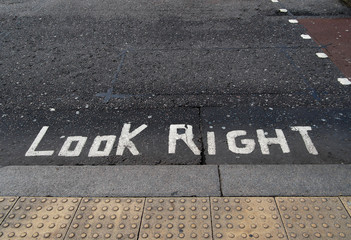 Look right written on tarmac road. Political metaphor maybe.
