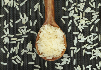 Parboiled rice in wooden spoon