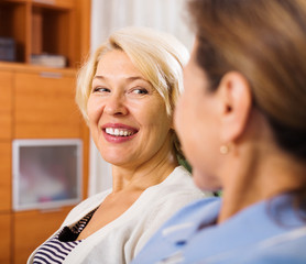 happy mature women talking at home