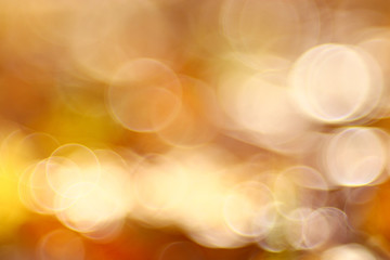 golden orange autumn background blur bokeh, defocusing lens