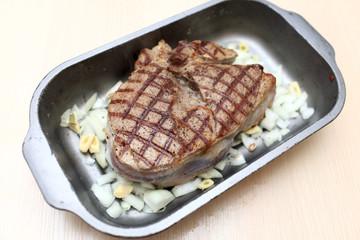 Blade steak in baking dish