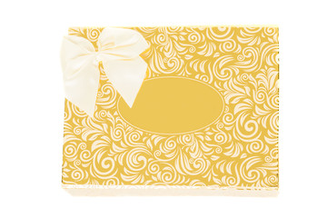 Golden gift box with bow tie