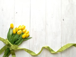 Yellow tulips bouquet  with ribbon