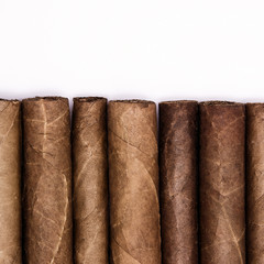 Cigars in a row with space for text. Close-up background
