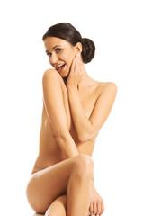 Slim spa woman sitting on the desk
