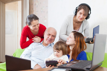 family of three generations uses few  electronic devices