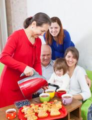 Mature woman pours tea