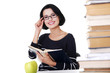 Happy woman sitting at a desk with stack of books