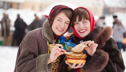 Young women eating pancake