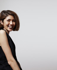 happy asian girl and white wall for text