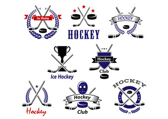 Ice hockey emblems with crossed sticks and pucks