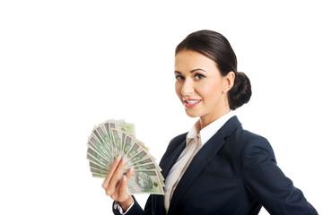 Businesswoman holding a polish money