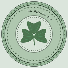 Green stamp with clover and the text Happy St. Patrick's Day, ve