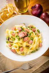 Fettuccine with ham and peas, Italian cuisine