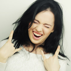 Funny woman doing hand sign