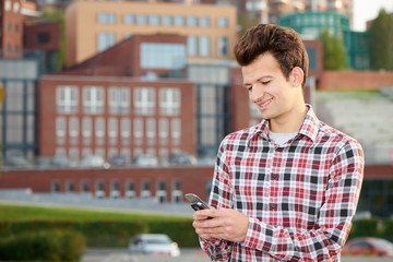 Man with cellphone outdoors
