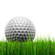 White golf ball in grass isolated