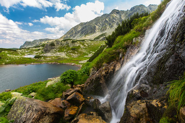 Beautiful waterfalls in the mountains, in summer