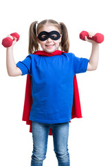child girl plays superhero and lifts dumbbells