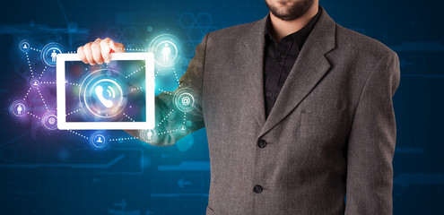 Businessman showing social networking technology with colorful l