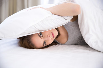 Young woman not being able to sleep
