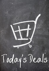 today's deals text and shopping cart on blackboard
